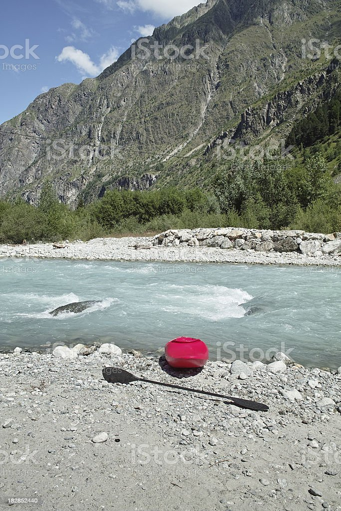 wild river with red boat in the alps stock photo