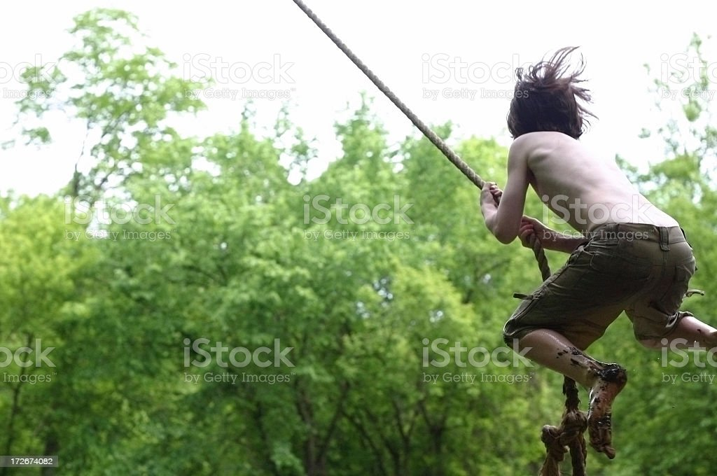Wild Rope Swing Jump stock photo
