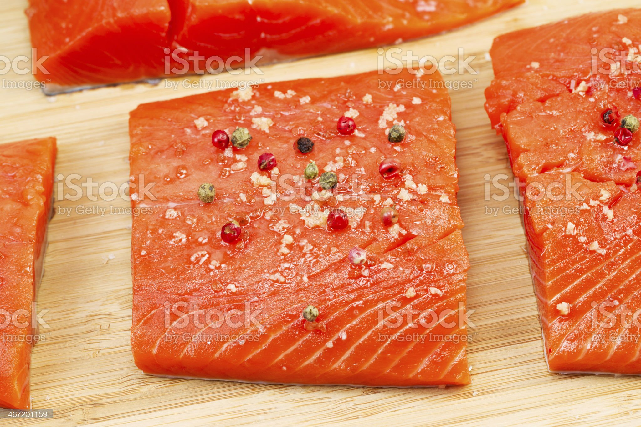 Wild Salmon coated with Sea Salt and Peppercorn royalty-free stock photo
