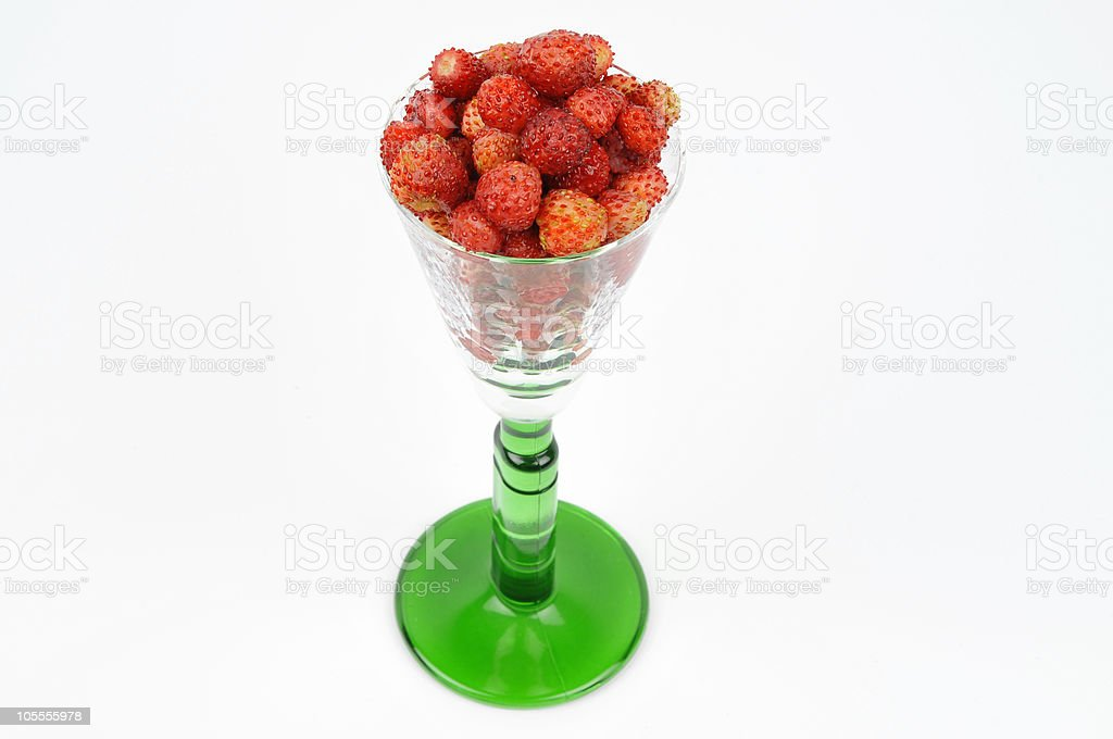 Wild Strawberries in Green Glass royalty-free stock photo