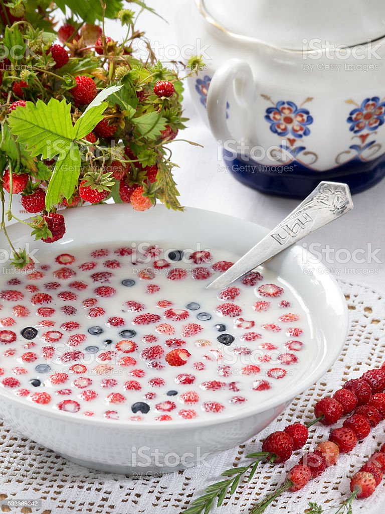 Wild strawberries with milk royalty-free stock photo