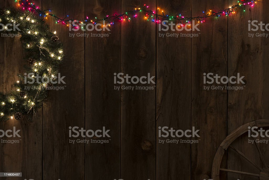 Wild West Barnwood Backgroud w/ wreath and colored lights royalty-free stock photo