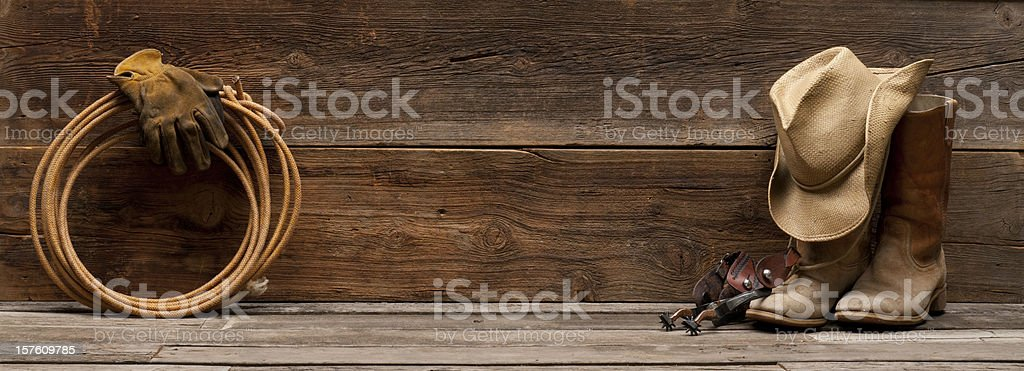 Wild West Barnwood Background w/boots,hat,spurs,rope stock photo