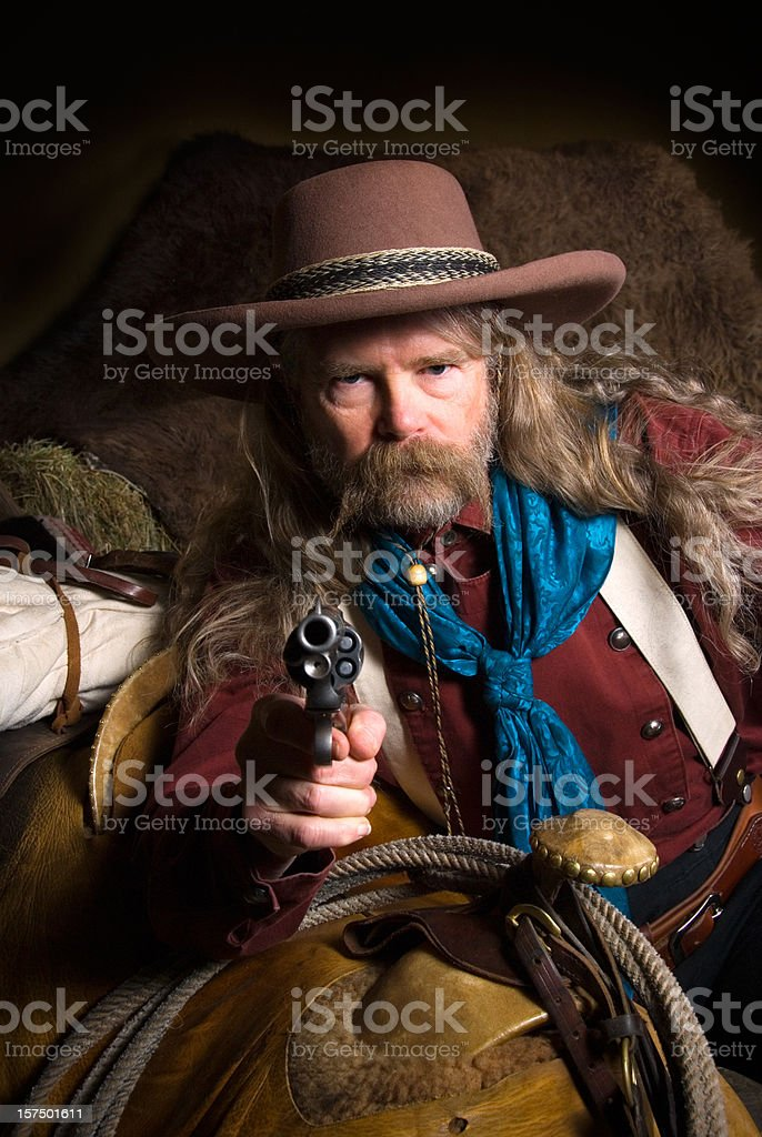 Wild West: cowboy in period clothing pointing a gun stock photo