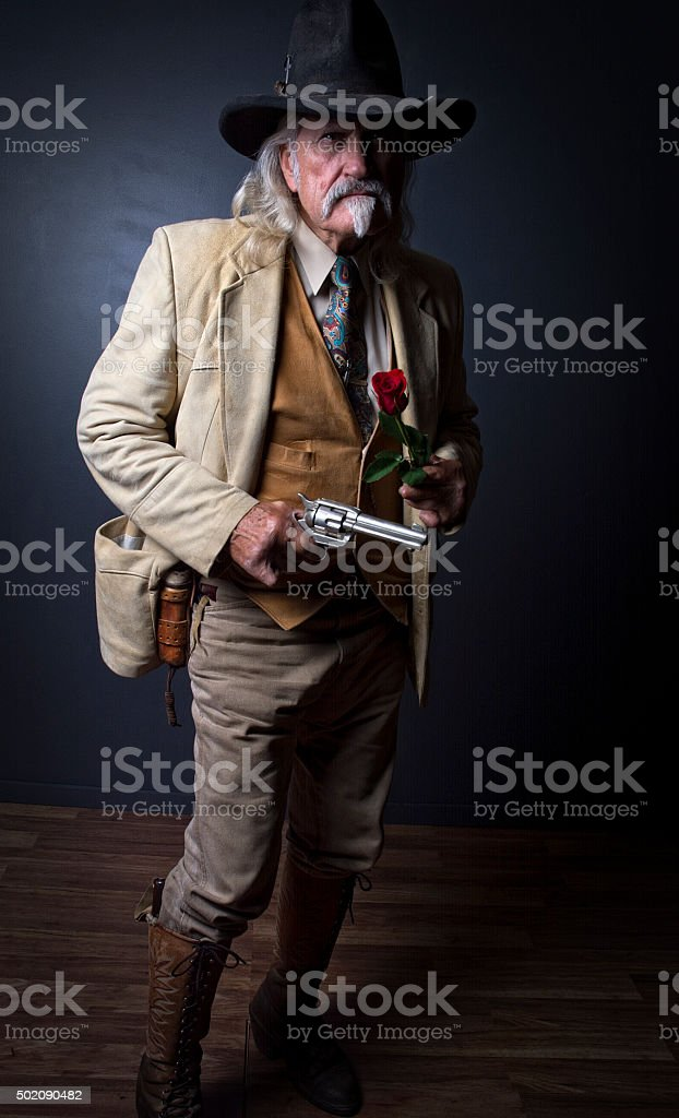 Wild West Cowboy Lawman Pose With Pistol stock photo