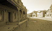 Wild West, old wooden buildings, houses, sepia toned