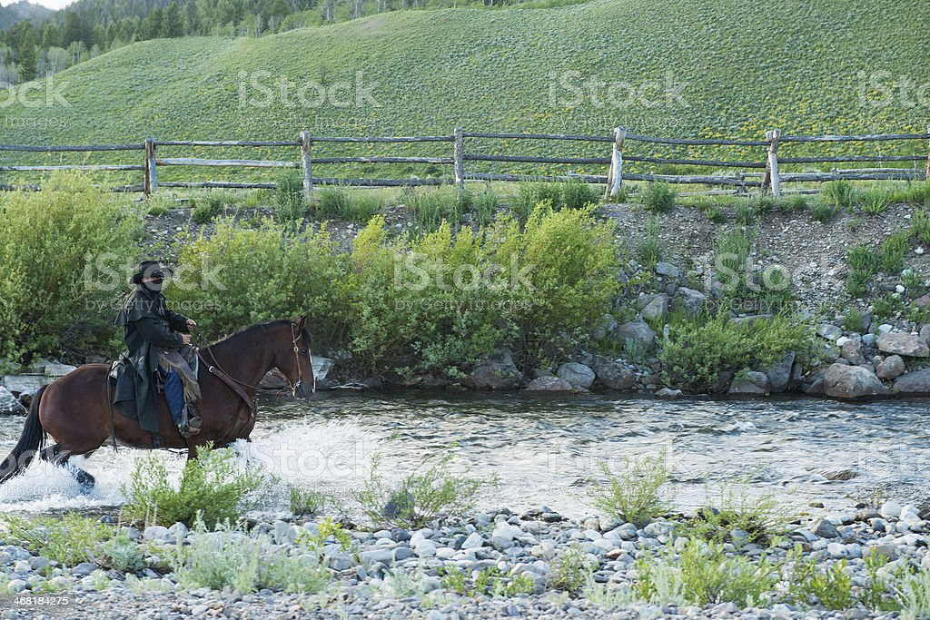 Wild West Outlaw on Horse stock photo