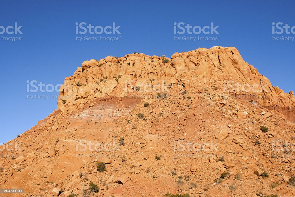 Wild West Scene: Red Mesa Against Blue Sky stock photo