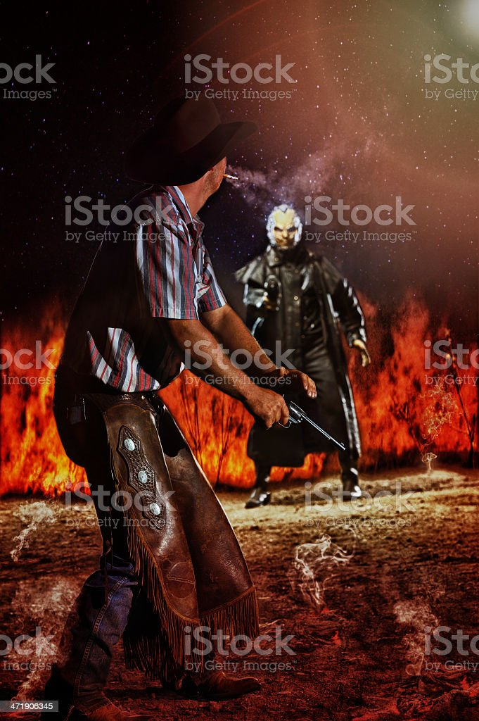Wild West Shoot Out Between Alien and Determined Cowboy stock photo
