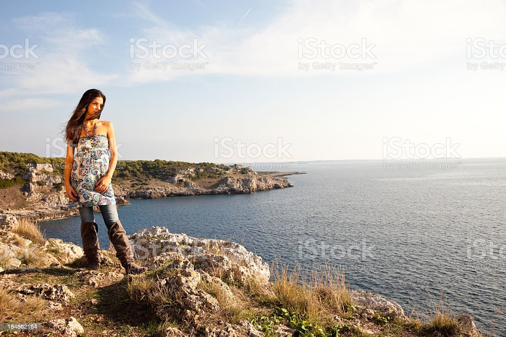 Wild Woman On A Cliff stock photo
