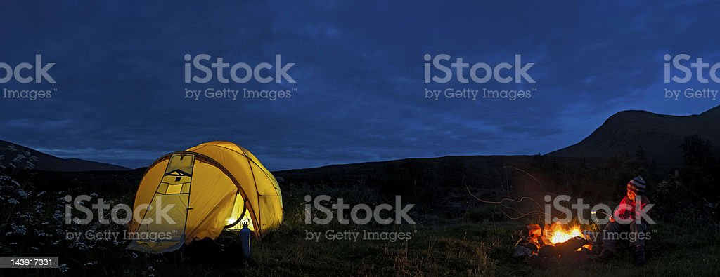 Wilderness camp fire child toasing marshmallows Scotland royalty-free stock photo