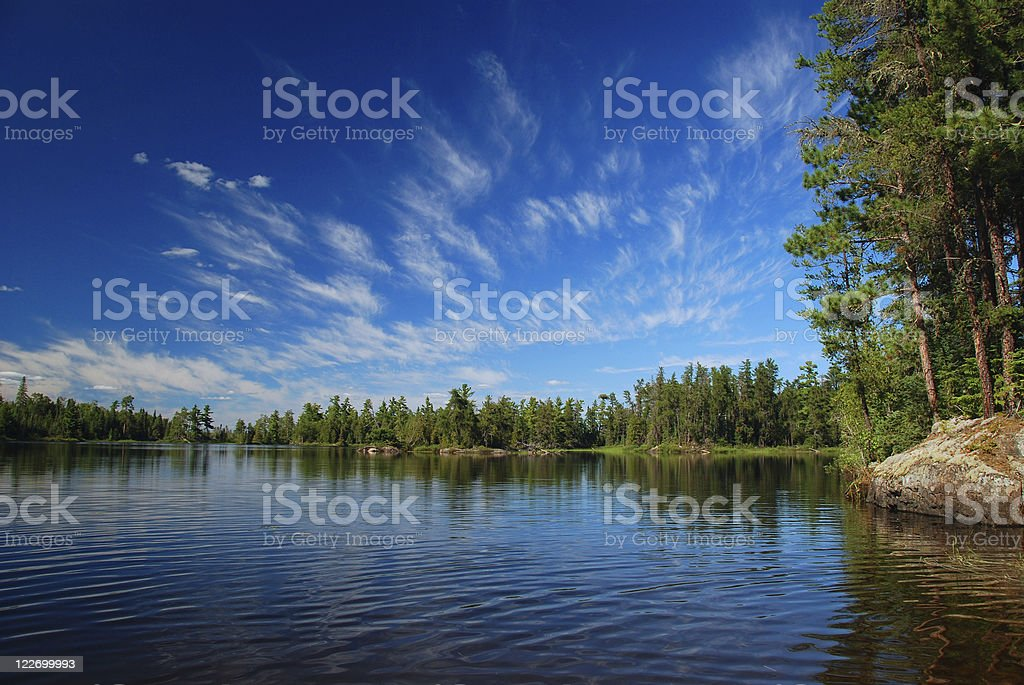 Wilderness lake and summer skies stock photo