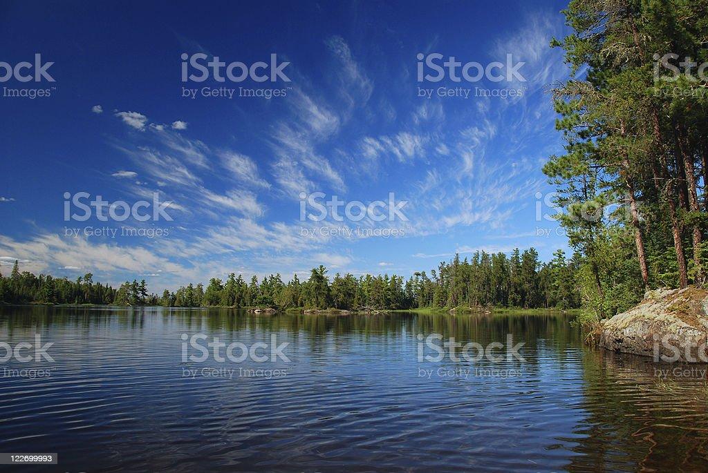 Wilderness lake and summer skies stock photo