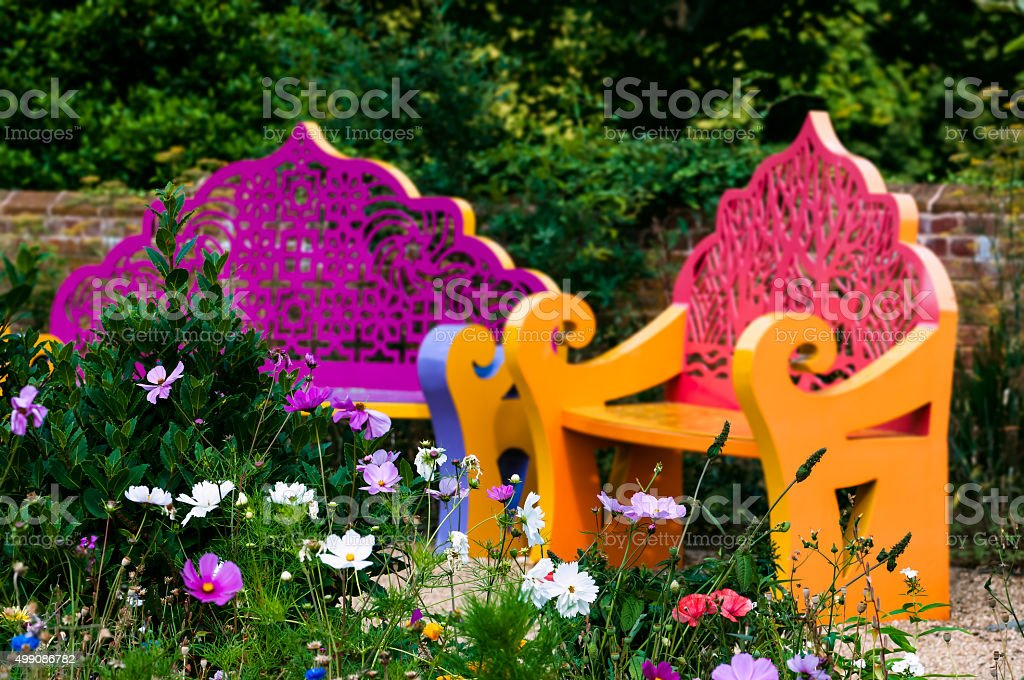 Wildflower garden and benches outdoor relaxing space stock photo