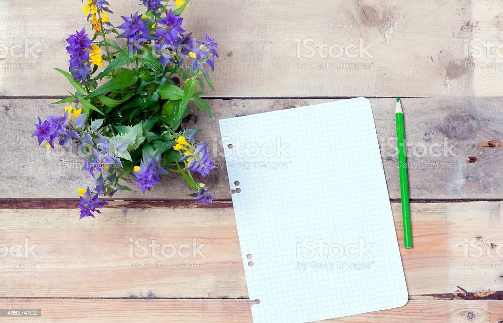 Wildflowers  on a wooden surface stock photo