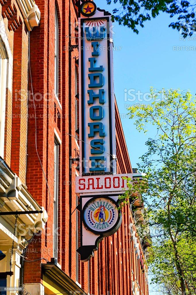 Wildhorses Saloon neon sign in downtown Nashville, TN stock photo