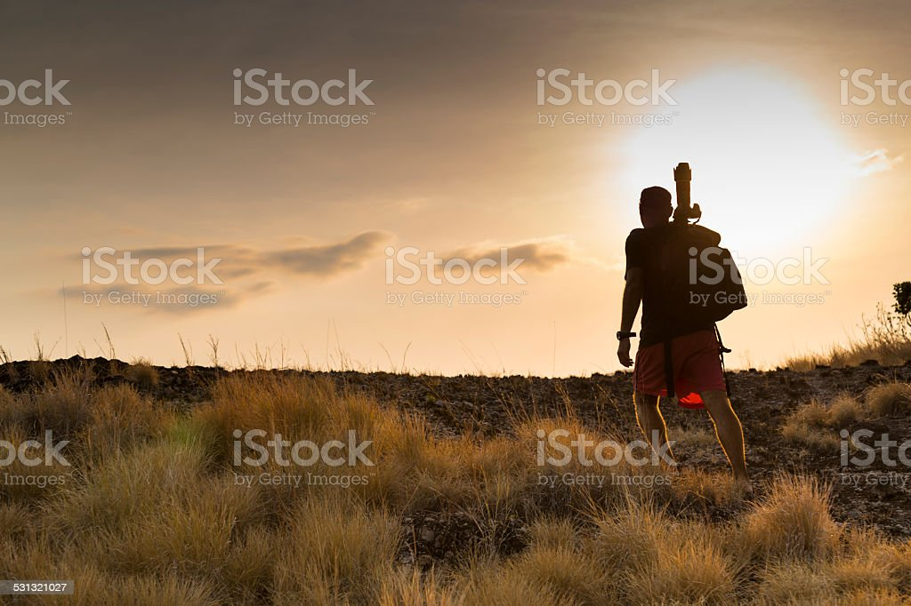 Wildlife photographer scouting locations at sunset stock photo