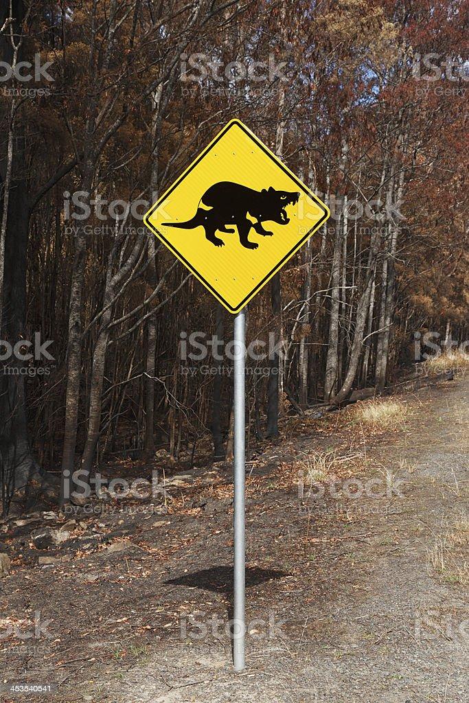 Wildlife warning sign near bushfire damage royalty-free stock photo
