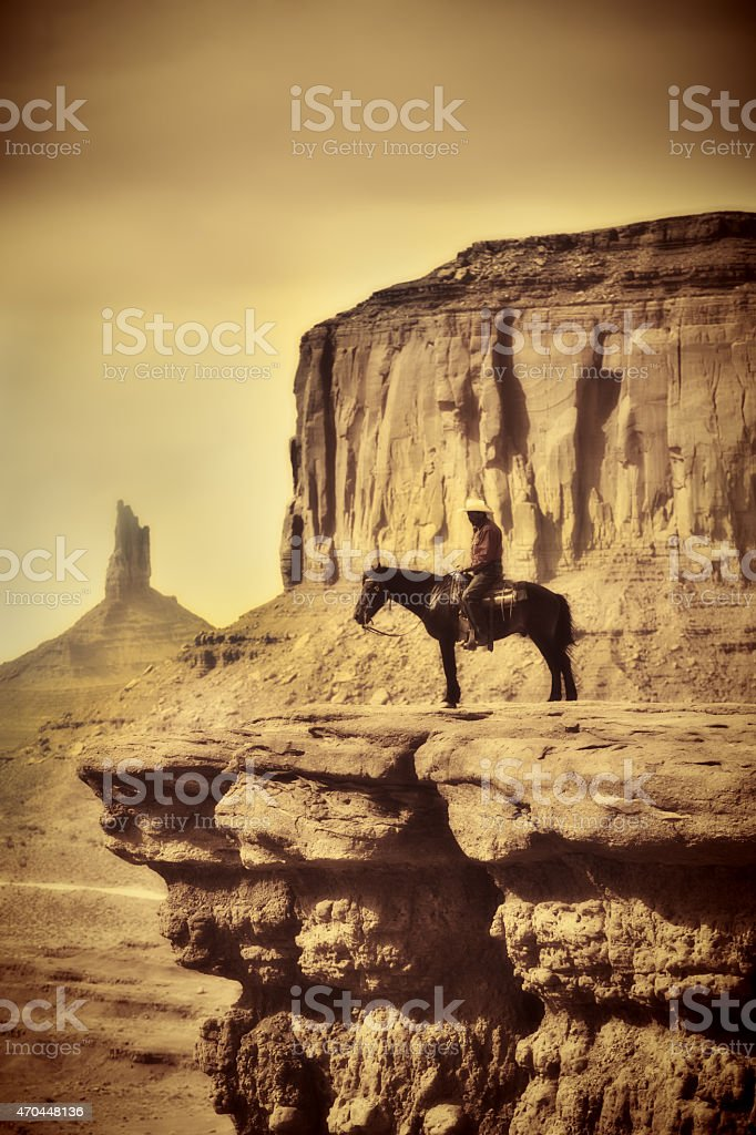 Wildwest Coyboy on Horse in Old Retro Antique Sepia Tone stock photo