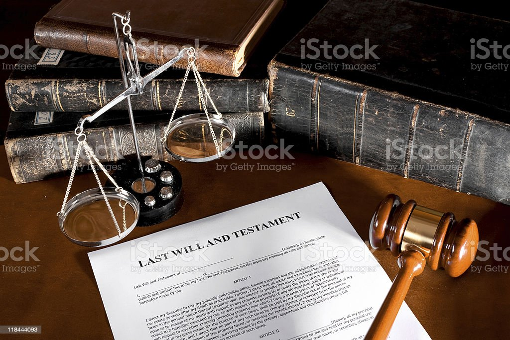 Will document on table with books stock photo