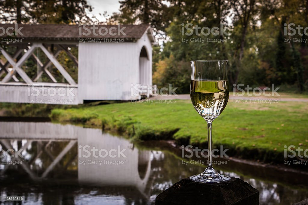 Willamette Valley Wine Glass Chardonnay Covered Bridge Reflection  Creek Oregon stock photo