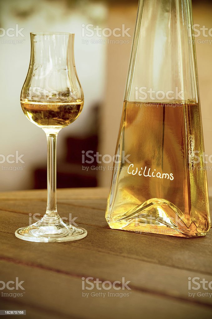 Williams Pear liqueur, German specialty spirit and glass royalty-free stock photo