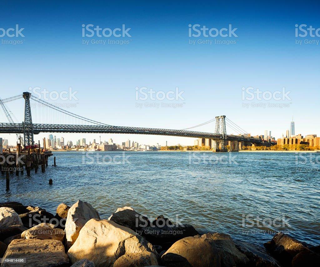 Williamsburg bridge Brooklyn and Manhattan skylines early Fall morning stock photo