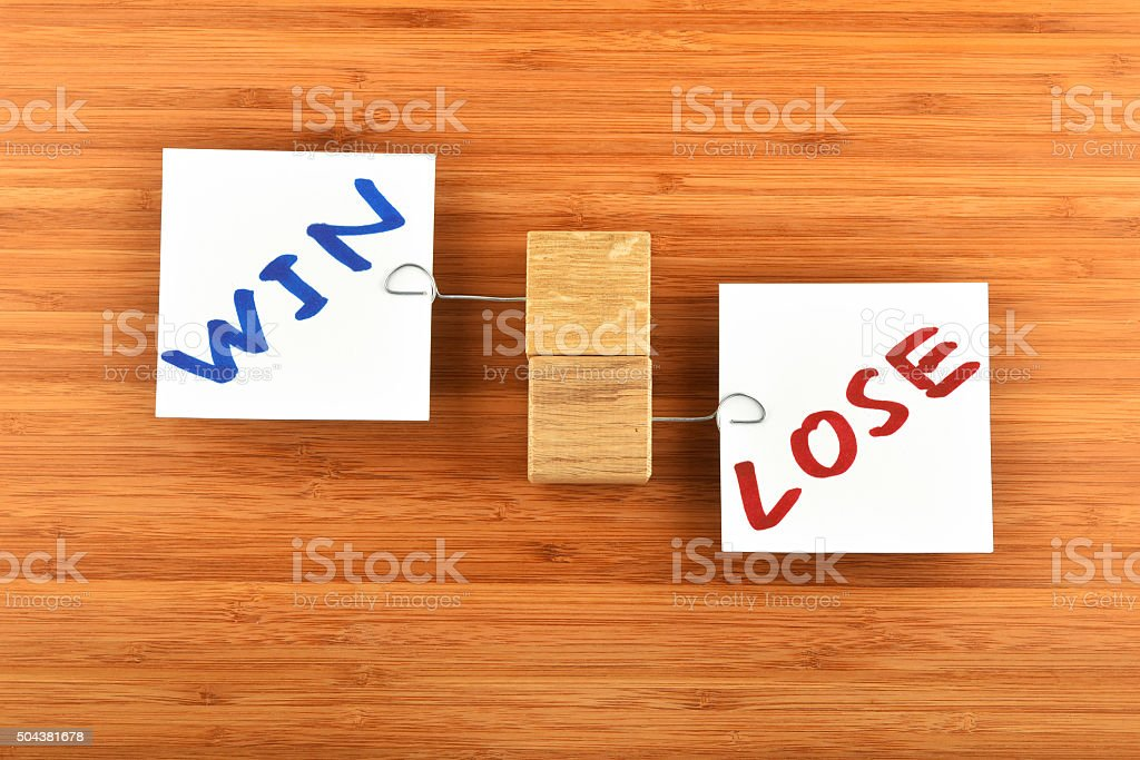 Win lose, two paper notes in different directions on wood royalty-free stock photo