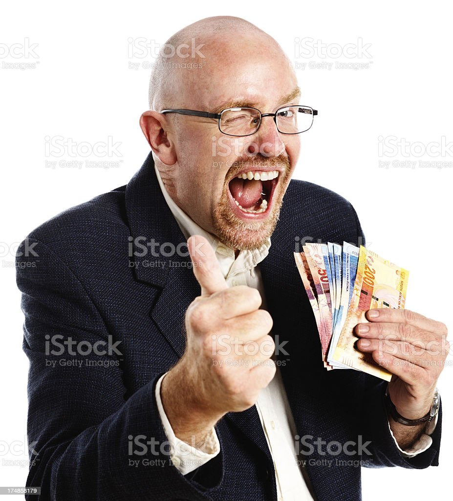 I win! Smiling winking man with money gives thumbs up! stock photo