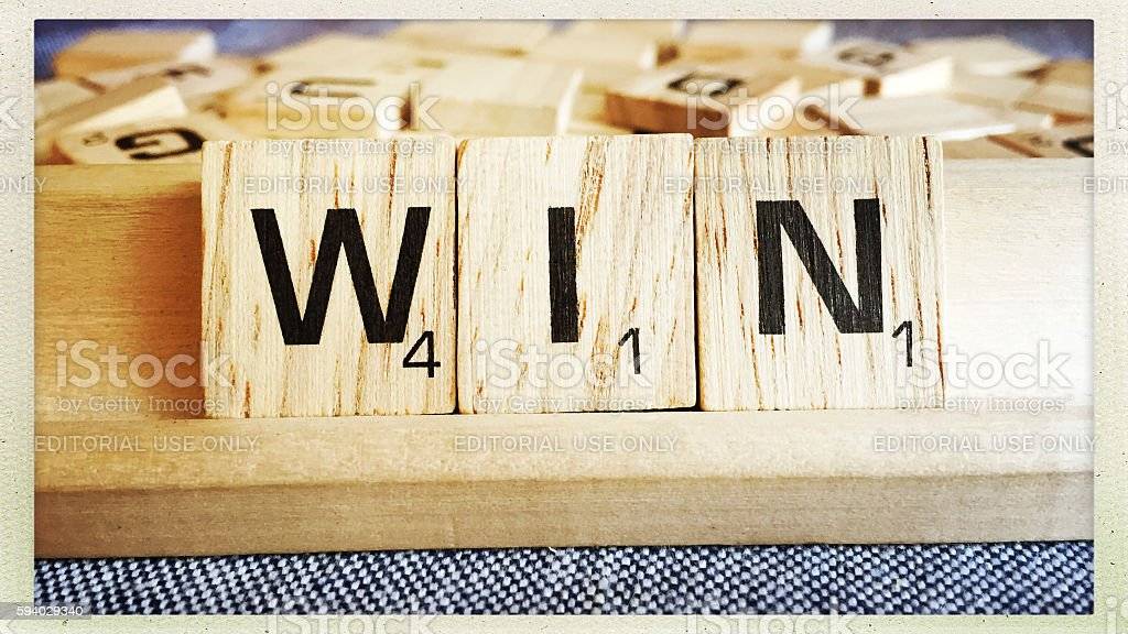 Win Spelled with Scrabble Tiles Letters stock photo