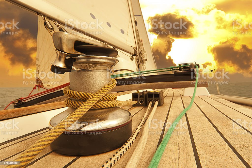 Winch with rope on sailing boat in the sea stock photo