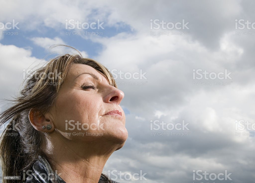 wind and closed eyes stock photo