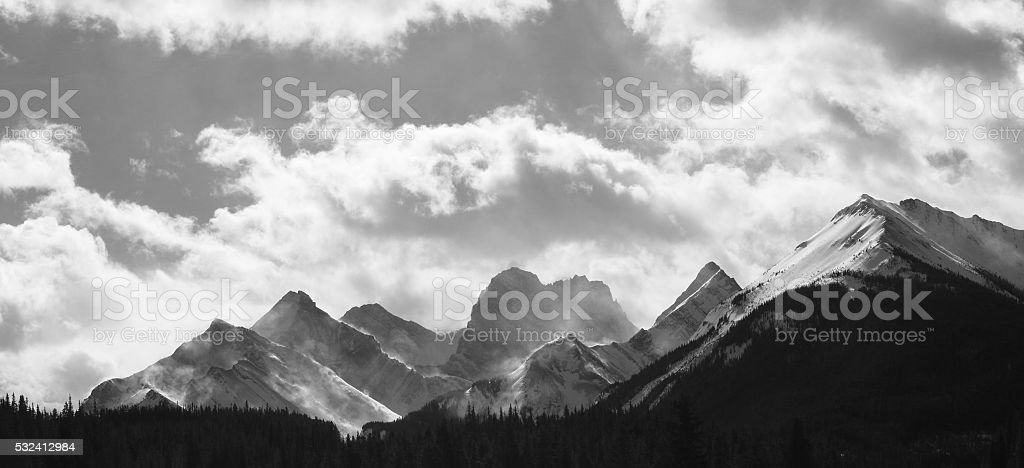 Wind Blowing Snow Off Mountain in Rockies stock photo
