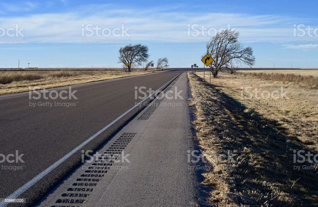 Wind blown curve in the road stock photo