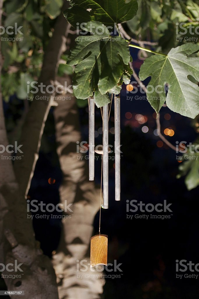 Wind chimes in the night stock photo