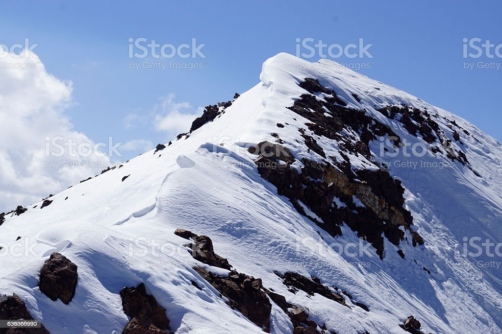 Wind drifts at the top of the mountain stock photo