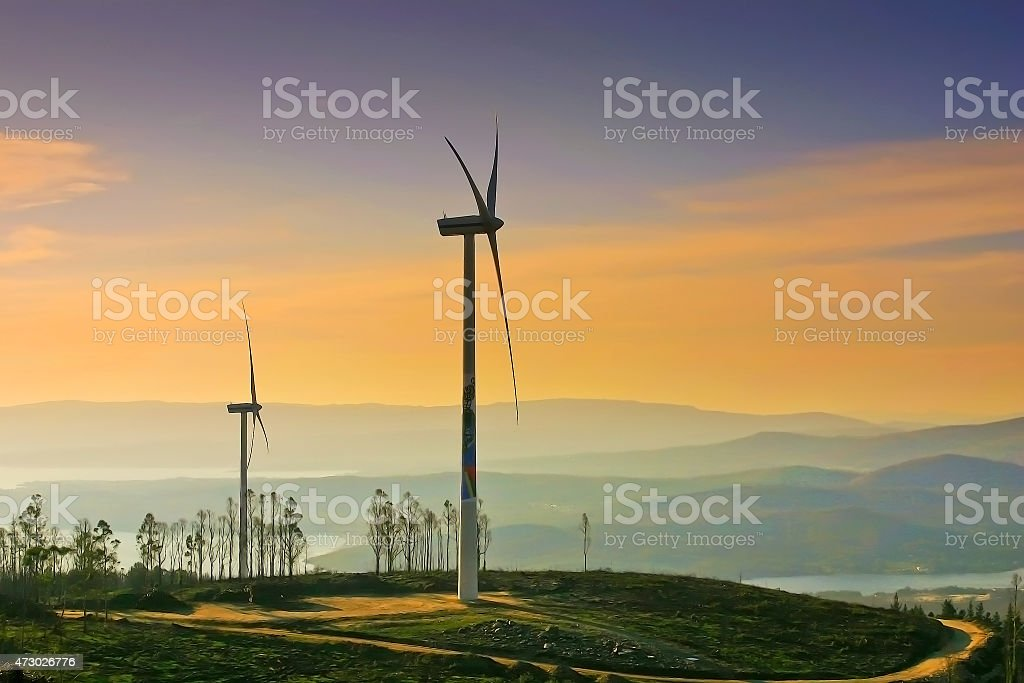 Wind Energy at sunset stock photo