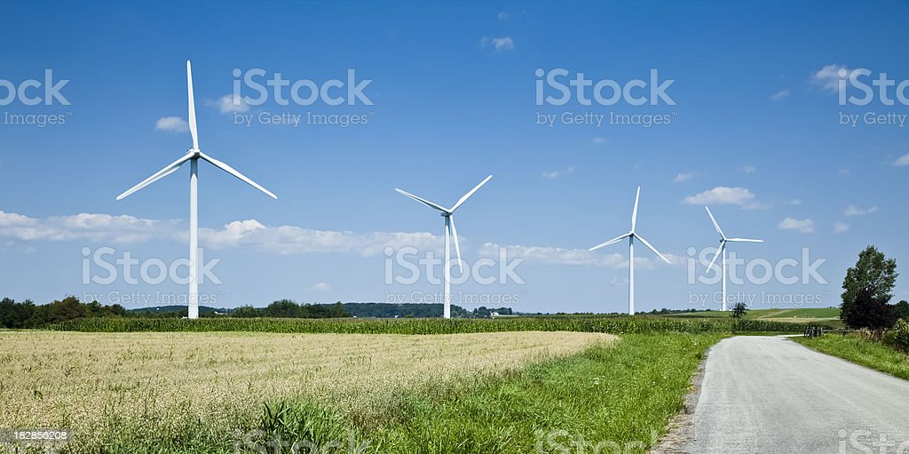 Wind Energy From Turbines Along a Farm Road in Pennsylvania royalty-free stock photo