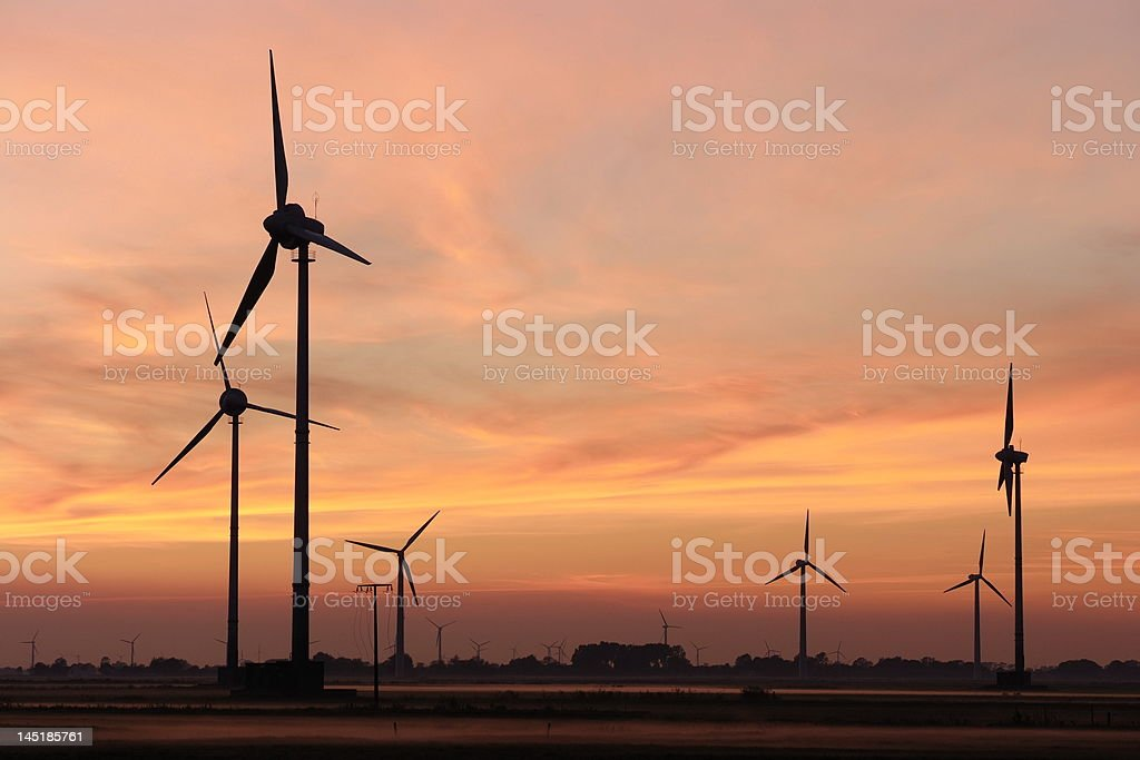 Wind energy plants at sunset royalty-free stock photo