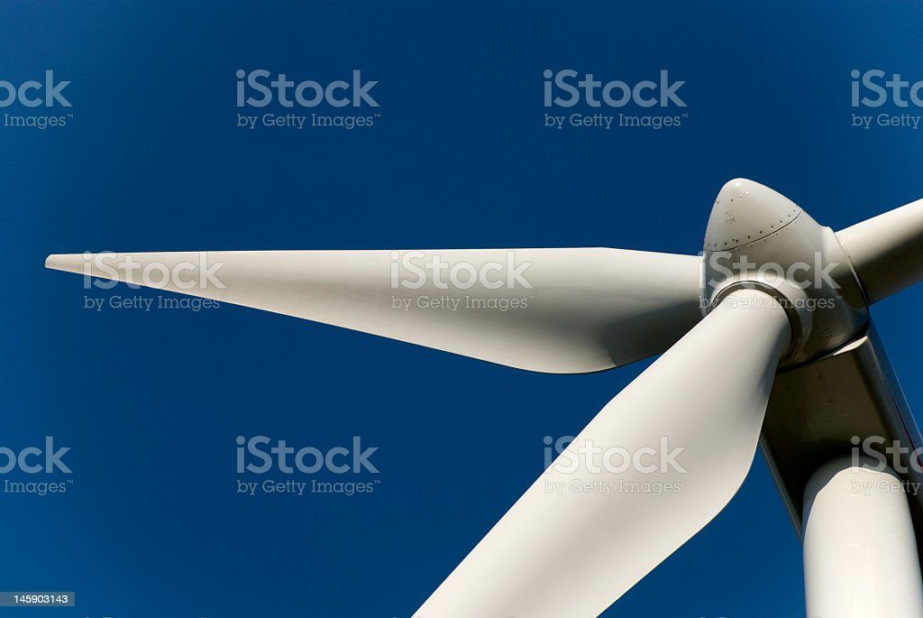 Wind energy wheel that is not spinning stock photo