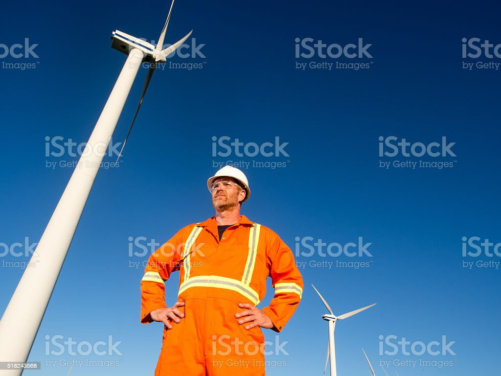 Wind Energy Worker and Alternative Power Turbine stock photo