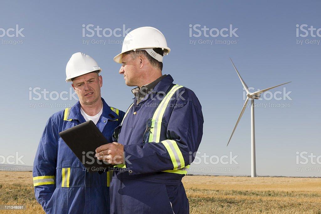 Wind Energy Workers stock photo