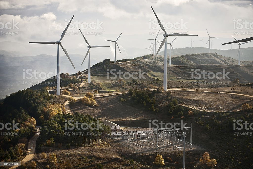 Wind farm  and electrical substation. stock photo