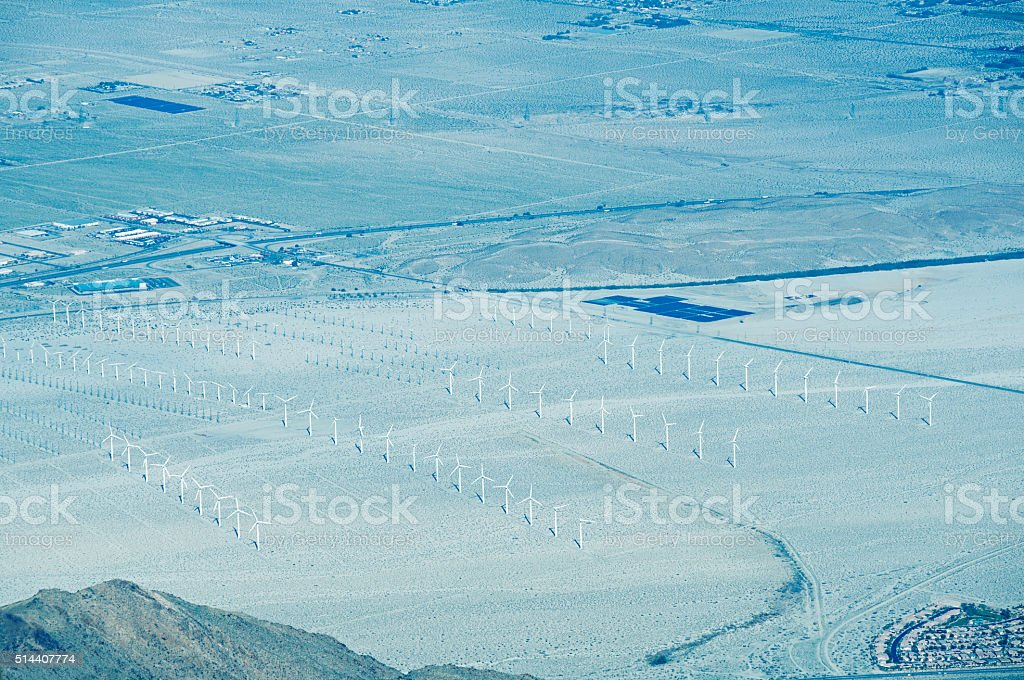 Wind farm and solar panels in Coachella Valley CA stock photo