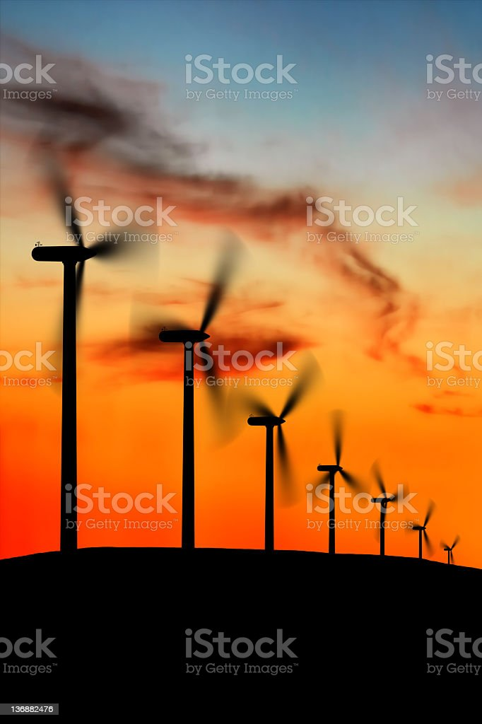 XXL wind farm at dusk stock photo