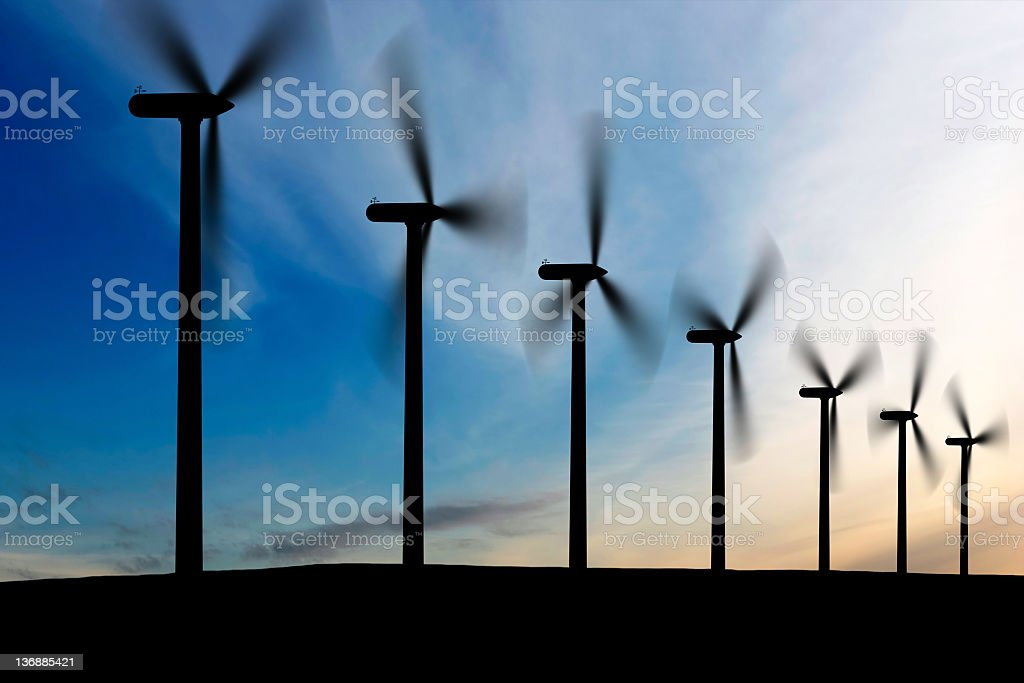 wind farm at dusk stock photo