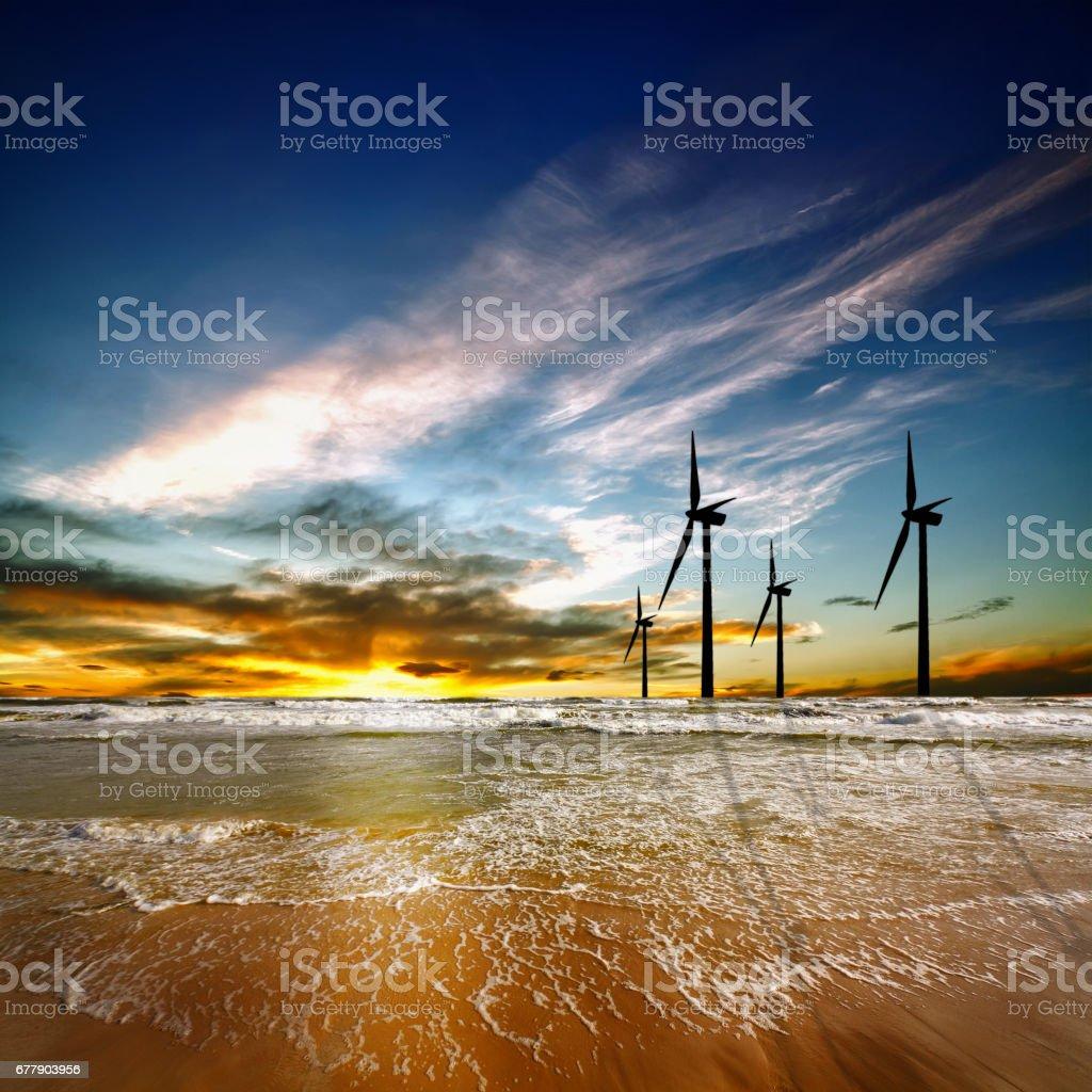 Wind farm at sunrise stock photo