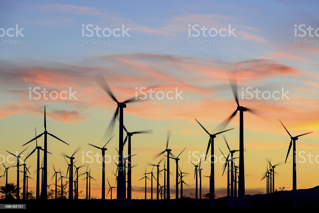Wind farm at sunset stock photo