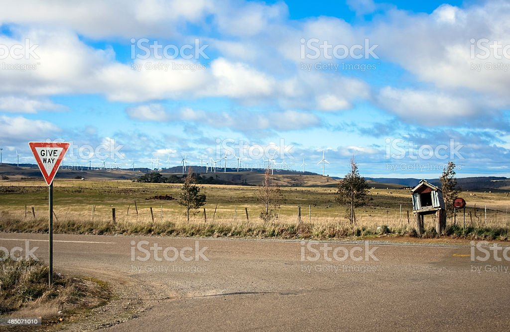 Wind farm behind road sign and letter box stock photo