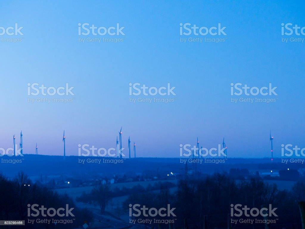 Wind farm in operation at sunrise stock photo